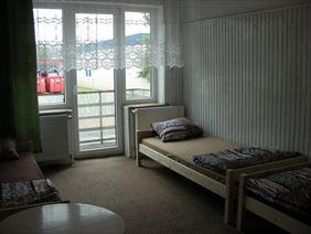 pokój z pojedynczym łóżkiem, Noclegi pracownicze Wojciech Kuźmiński, Łódź