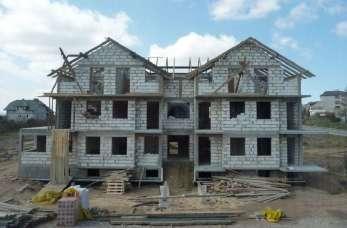 Jakie prace w ramach budowy domu pod klucz wykonują specjaliści?